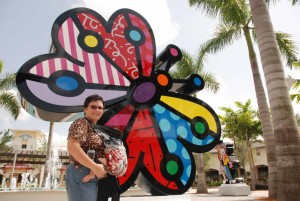 Renee in front of a Britto installation